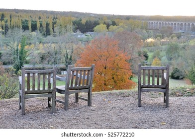 Armchairs in wood in front of a beautiful landscape with a great bridge