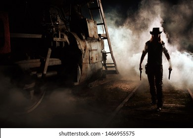 armed cowboy silhouette at night at the train with smoke