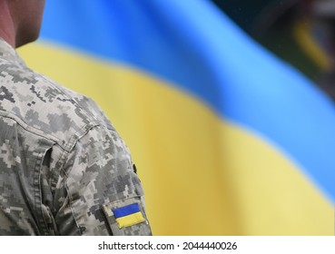 Armed Forces of Ukraine. Ukrainian soldier. Ukrainian in army. Ukrainian flag on military uniform.