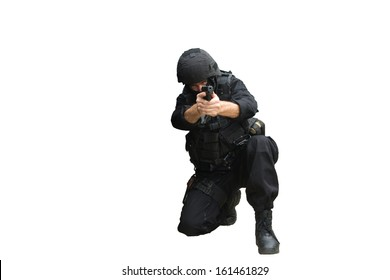 Armed masked man kneeling and pointing a gun