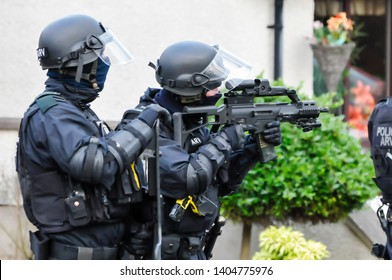 Armed police keep guard at a security situation.