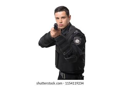 Armed police officer aims with a gun
