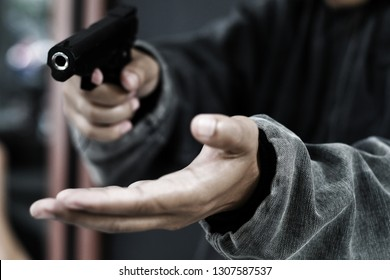 Armed robbers pointing a handgun to robbery the money, Uses Gun in Armed Robbery, Gun Point , used for the illustration or montage of your design, Banner for advertise of product