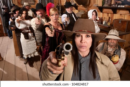 Armed saloon customers with pistols in old western scene