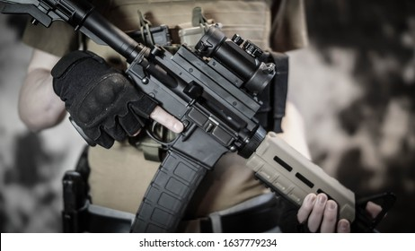 Armed security contractor holding an AR15 rifle.