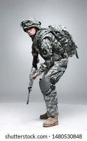 Armed soldier holding a rifle.