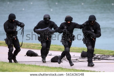 Armed soldiers taking out terrorist
