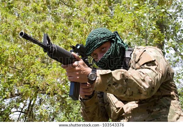 armed terrorist, freedom fighter, a masked killer