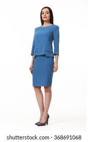 armenian asian eastern brunette business executive woman with straight hair style in blue blouse and  skirt suit  high heels shoes full length body portrait standing isolated on white