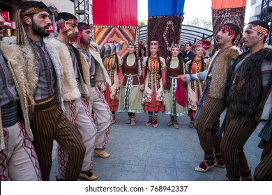 Armenian ensemble dancing, Yerevan, Armenia, October 2012: A group of dancers perform a traditional Armenian dance in the streets of Yerevan during the city´s anniversary celebrations