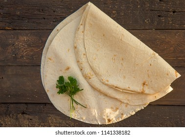 Armenian flat bread lavash. Pita bread on woden background. Copy space. Top view or flat-lay.