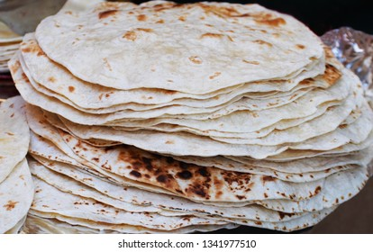 Armenian flat bread lavash. Plain Wheaten Flat Bread . Fresh Homemade Flatbread also known as Pita Bread