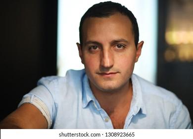Armenian handsome man portrait smoking hookah in cafe