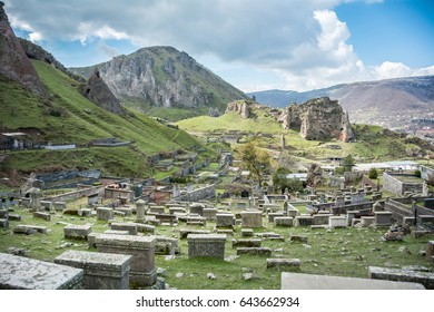 An Armenian Orthodox Christian cemetery in Old Goris, a beautiful natural area filled with rock spire formations that surrounds the city of Goris, Armenia