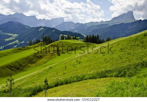 Armentara hilly meadows above La Val, Alta badia, Dolomites, South Tyrol, Italy