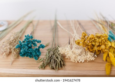 Armfuls of dried flowers standing in a vase. Beautiful dried flowers of delicate shades. Materials for a workshop on making bouquets