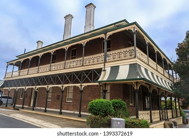 ARMIDALE, AUSTRALIA – April 10, 2019: Facade of the heritage listed Lands Board Office, built in 1887 in brick with Victorian architecture, surrounded by an elegant verandah with beautiful balustrade