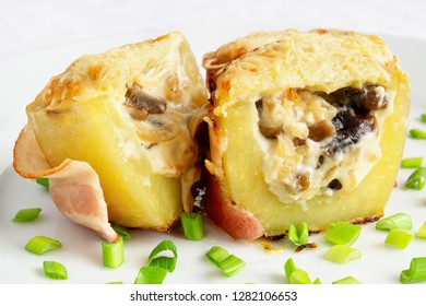 armillaria julienne served in potato wrapped in bacon and decorated with green onion