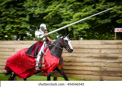 Armored knight on horseback charging in a joust with the lance raised. Jousting is a martial game or hastilude between two horsemen wielding lances with blunted tips, often as part of a tournament