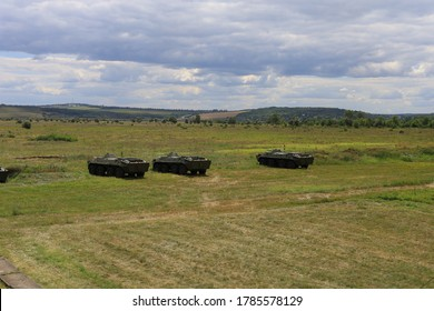 Armored personnel carrier infantry fighting vehicle. Military background with copyspace. Lots of heavy equipment.