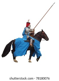 Armoured medieval knight on horseback charging with lance - isolated on white