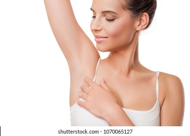 Armpit epilation, lacer hair removal. Beauty Young Woman holding her arms up and showing clean underarms, depilation smooth clear skin. Beauty portrait. Beautiful Brunette Girl after removal hair