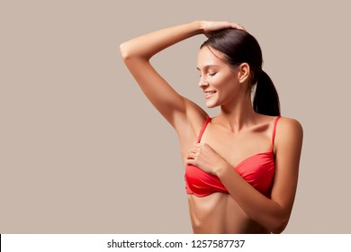 Armpit epilation, lacer hair removal. Young woman holding her arms up and showing clean underarms, depilation, smooth skin. underarm odorless and sweat. Beauty portrait model after hair removal.