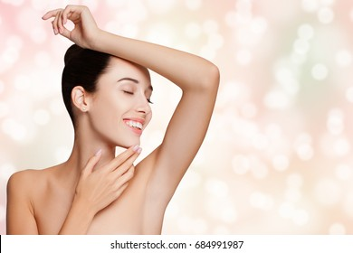 Armpit Epilation, Lacer Hair Removal. Young Woman Holding her Arms up and Showing Clean Underarms, Depilation smooth Clear Skin. Beauty Portrait smooth skin