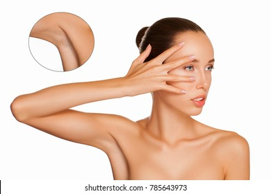 Armpit Epilation, Lacer Hair Removal. Young Woman holding her arms up and showing clean underarms, depilation smooth skin. Beauty portrait model after hair removal, example of the armpit before hair