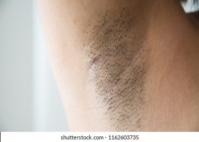 Armpit and armpit hair of Asian women on white background