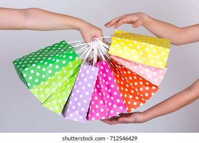 Arms with colorful shopping bags