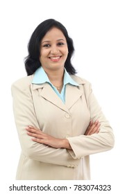 Arms crossed confident Indian woman against white background