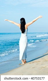 Arms outstretched balance beach walking female