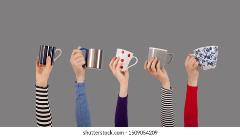 arms raised and holding many coffee cups