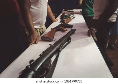 Arms trafficking. different rifles on the counter in the gun shop. clandestine sale of weapons. illegal purchase of weapons. firearms on the table. illegal deal to sell weapons
