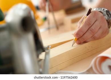 Arms of worker making structure plan on scaled paper closeup. Manual job DIY inspiration improvement job fix shop graphic joinery startup workplace idea designer career wooden bar ruler