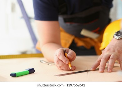 Arms of worker making structure plan on scaled paper closeup. Manual job DIY inspiration improvement job fix shop graphic joinery startup workplace idea designer career industrial education