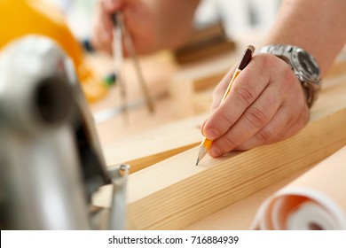 Arms of worker making structure plan on scaled paper closeup. Manual job, DIY inspiration, improvement job, fix shop graphic, joinery startup, workplace idea, designer career, wooden bar, ruler