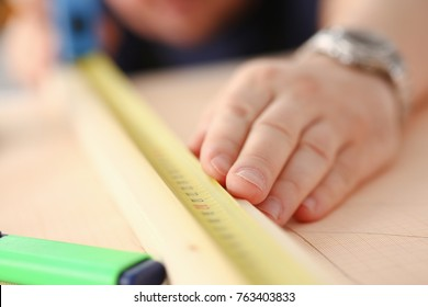 Arms of worker measuring wooden bar portrait. Manual job DIY inspiration improvement job fix shop yellow helmet joinery startup workplace idea hard hat career ruler industrial education
