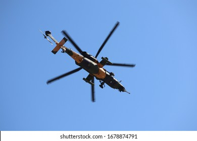 Army attack helicopter low flying.