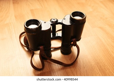army binocular on a wooden surface