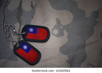 army blank, dog tag with flag of taiwan on the khaki texture background. military concept