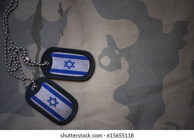 army blank, dog tag with flag of israel on the khaki texture background. military concept