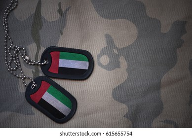 army blank, dog tag with flag of united arab emirates on the khaki texture background. military concept