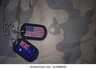 army blank, dog tag with flag of united states of america and australia on the khaki texture background. military concept