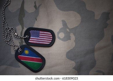 army blank, dog tag with flag of united states of america and namibia on the khaki texture background. military concept