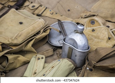 Army equipment laying on the ground .