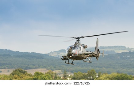 Army helicopter flies at very low level
