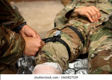 Army medics practicing tourniquet application