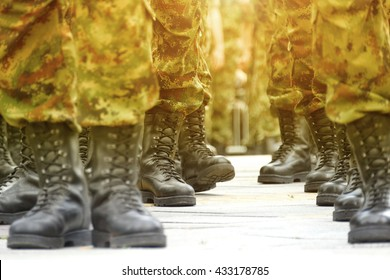 Army, Military Boots ;  lines  of commando soldiers in camouflage uniforms